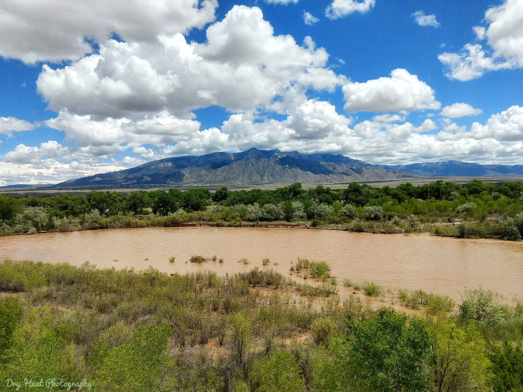 Flooded Rio Grande River and Sandia Mountains as seen from Rio Rancho, New Mexico.