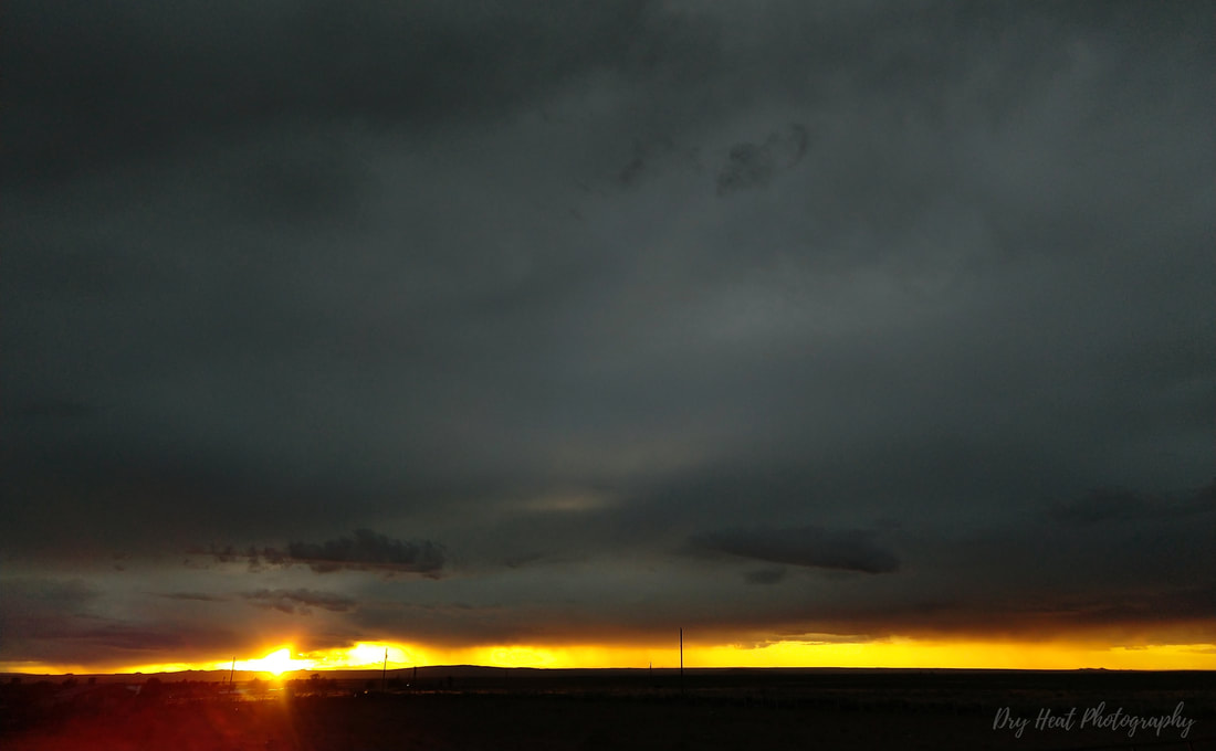 Sunset and storm clouds in Meadow Lake, New Mexico