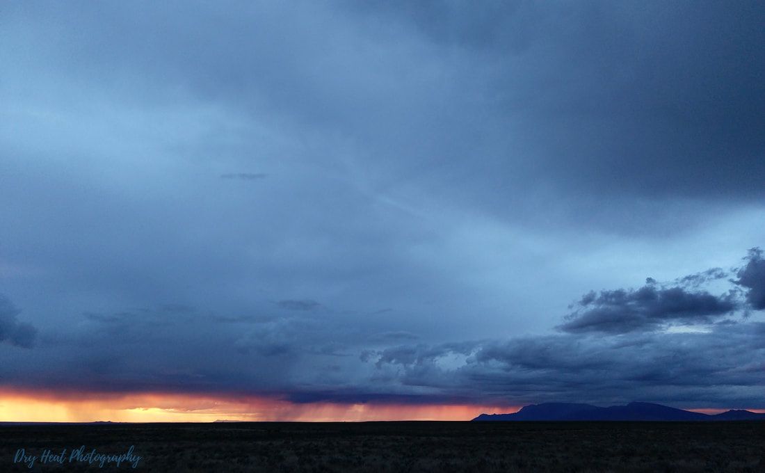 Monsoon storm and sunset over the Sandia Mountains.
