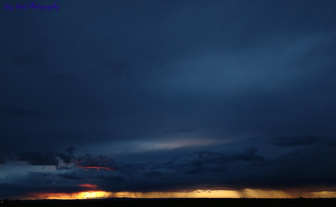 Monsoon storm and sunset in Meadow Lake, New Mexico