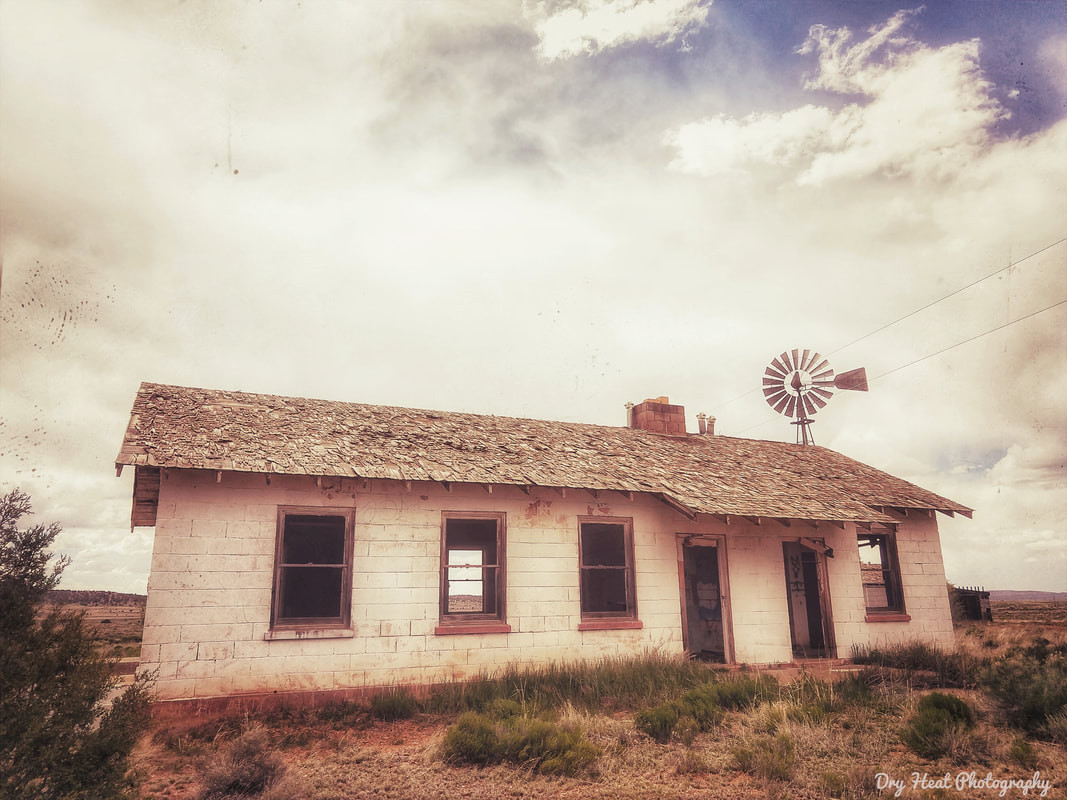 Abandoned house with windmill in Ramah, New Mexico.