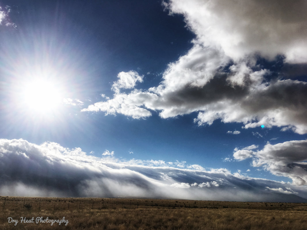Tidal wave of clouds over the Manzano Mountains in New Mexico. Dry Heat Photography