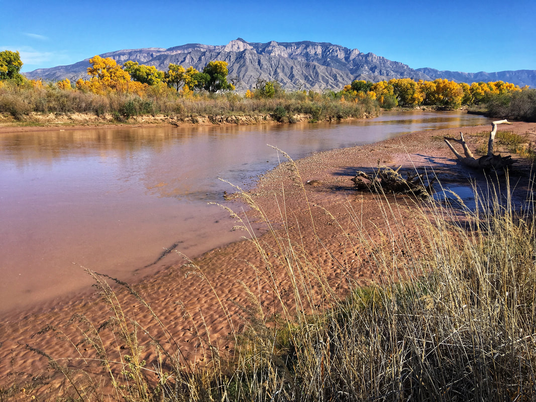Rio Grande River and Sandia Mountains as seen from Corrales, New Mexico. Dry Heat Photography