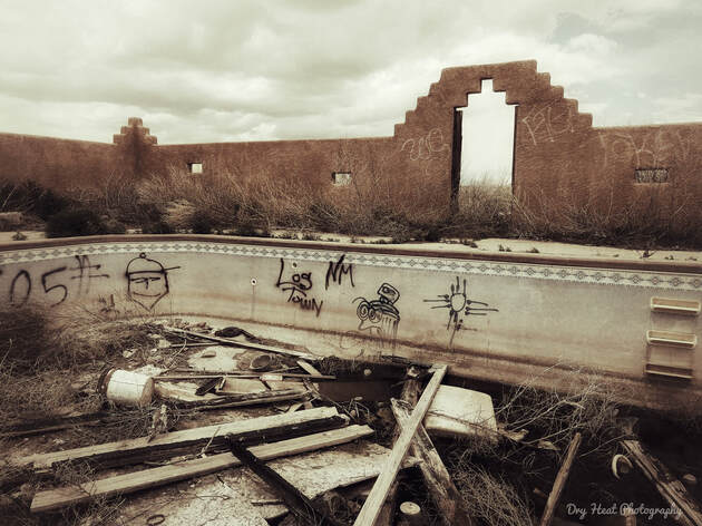 Abandoned swimming pool of a burned down house in Meadow lake, New Mexico